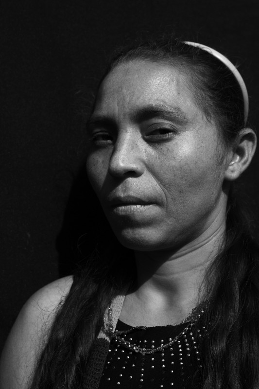 Elsi Salcedo, 36, was born in El Carmen but displaced in 2000 from her family's finca in El Salado, where one of the armed conflict's most notorious massacres took place. Between the 16th and 21st of February, 2000, 450 paramilitaries killed 60 people, resulting in a massive exodus, leaving El Salado abandoned. In total, however, 354 people were killed in El Salado from 1999-2001. Elsi was at the Oficina checking in on the status of her housing request, a possibility for some people who qualify. She was raised by her grandparents; her father was absent, and they say her Mother died when struck by a lightning bolt.