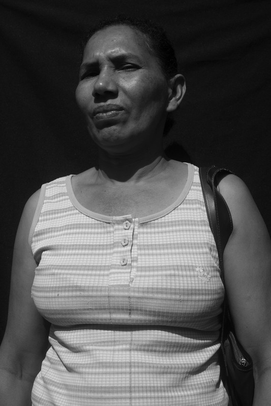 "Displaced from her finca La Sierrita in Sierra Donado in 1997, Miriam registered as a victim of forced displacement in 2000, and has since received two humanitarian aid payments. She's currently waiting to hear the status of her request for housing (""la vivienda""), again. She has 12 children between the ages of 10 and 34 and works at home, while her husband works odd jobs around El Carmen."