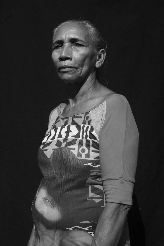 "Luisa Victoria, 64, was forcibly displaced from La Negra Coloso on October 2nd, 2001. ""They burned our ranch; we left with the clothes we had on."" That same year her daughter became a desaparecida. Whe now cares for her grandchildren as her own. They are 8 and 11. She's been checking in on the status of her humanitarian aid for three months."